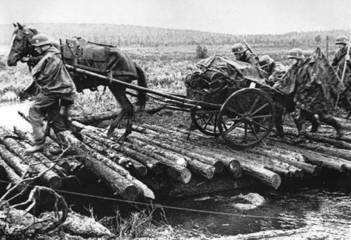 German soldiers move a horse-drawn vehicle over a coduroy road while crossing a wetland area, in October 1941, near Salla on Kola Peninsula, a Soviet-occupied region in northeast Finland. (AP Photo)